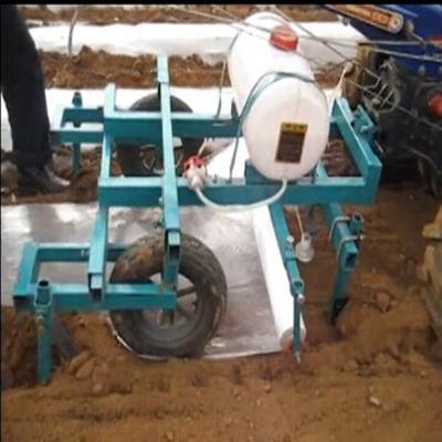 这是一张关于铺膜机 的产品图片