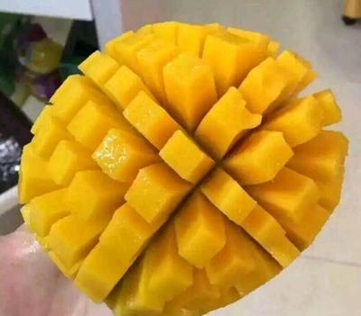 这是一张关于芒果 7两以上 5斤包邮25.9元一箱的产品图片